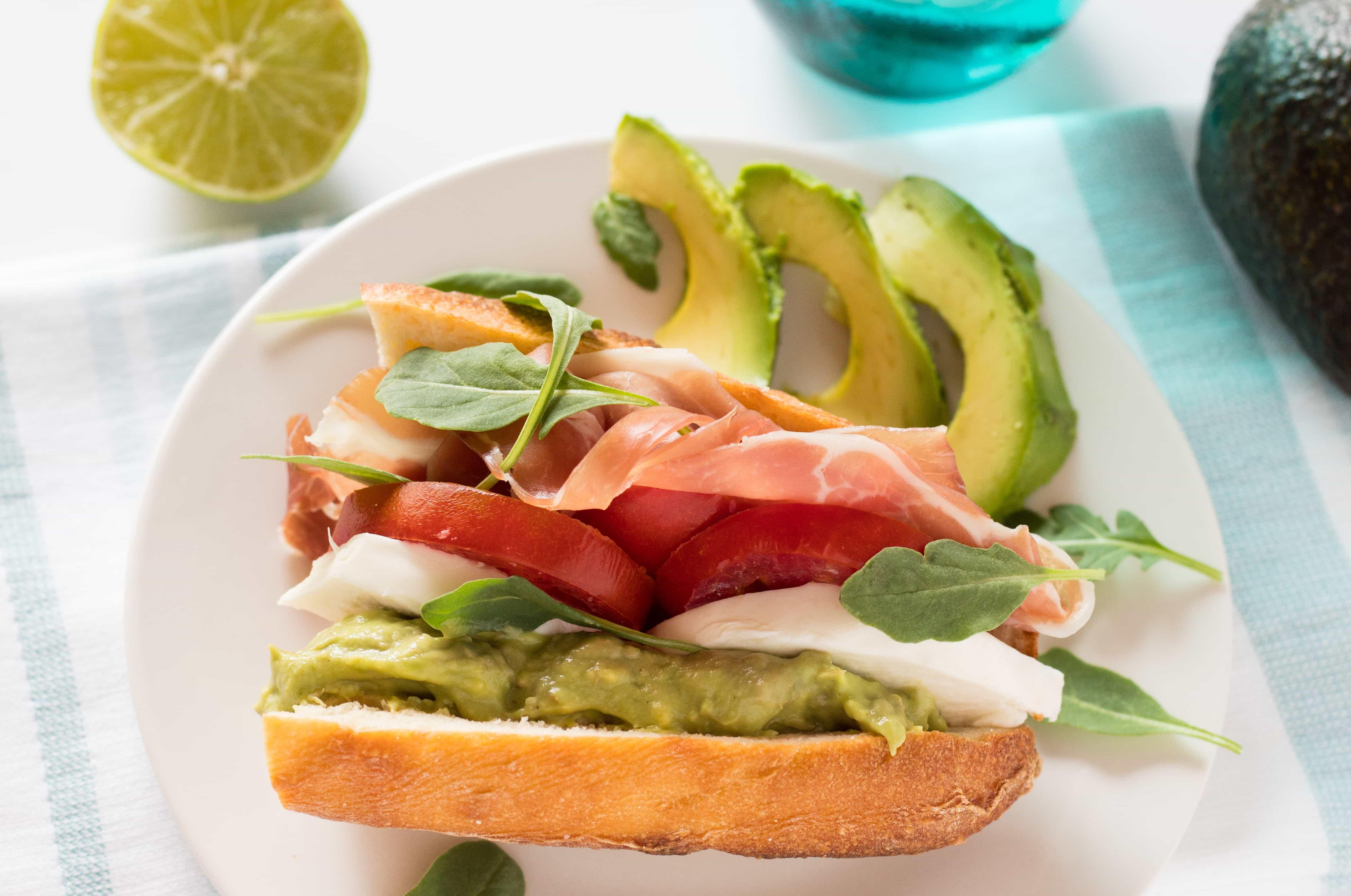 Prosciutto, Tomato, Cheese and Arugula Sandwich with Avocado Spread
