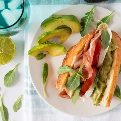 Prosciutto, Tomato, Cheese and Arugula Sandwich with Avocado Spread