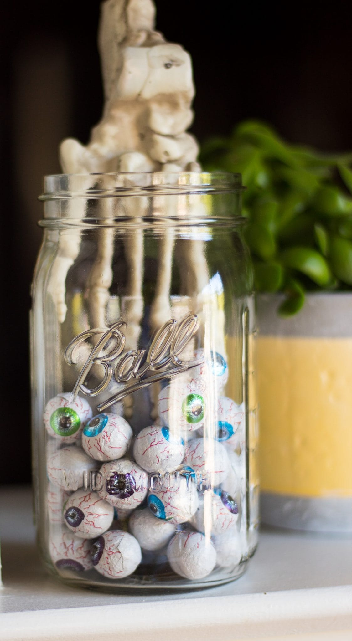 Hand Caught in a Candy Jar of Eyeballs- Cheap and Easy Halloween Decorating Ideas