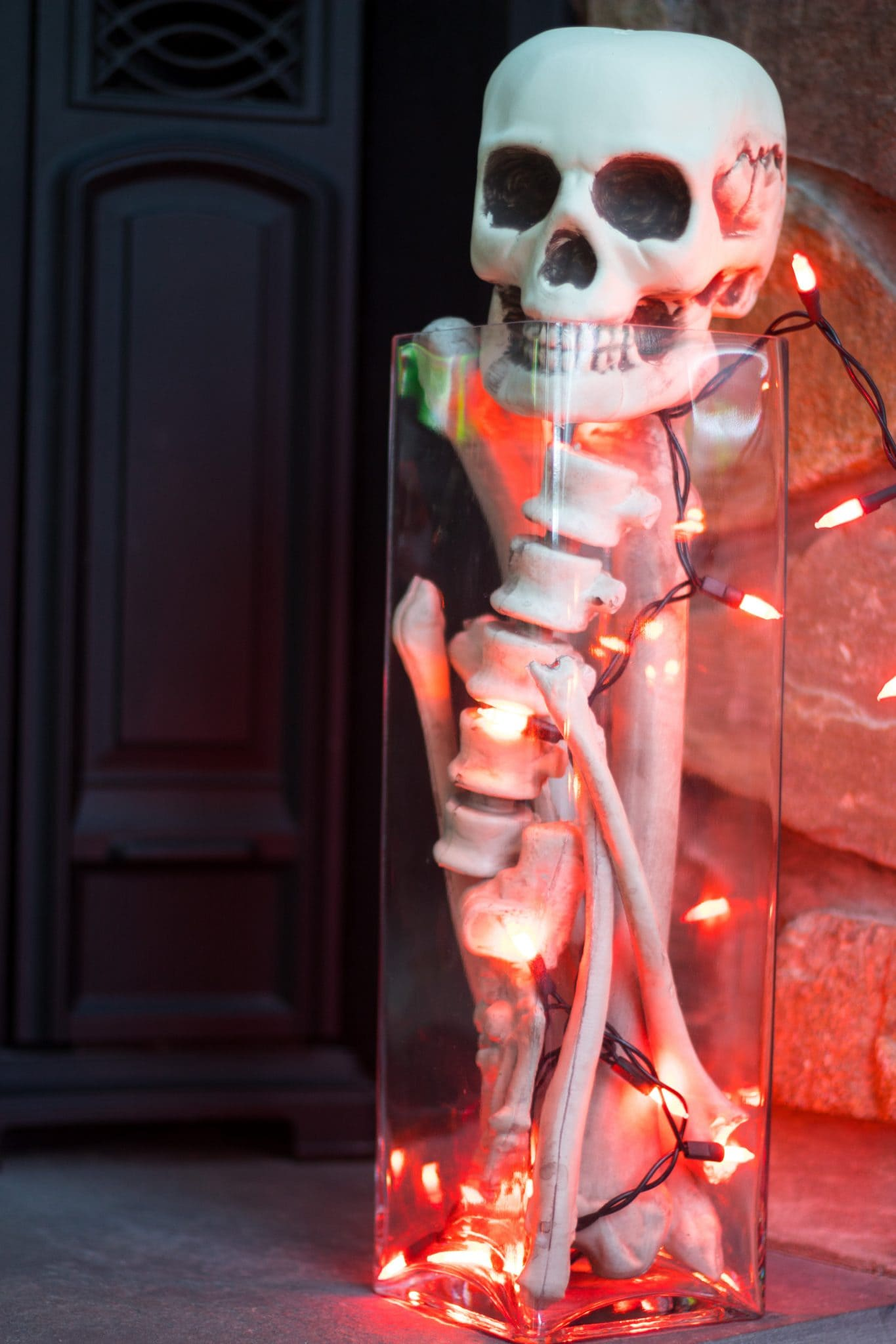 Skeletal Parts in a Tall Glass Vase- Cheap and Easy Halloween Decorating Ideas