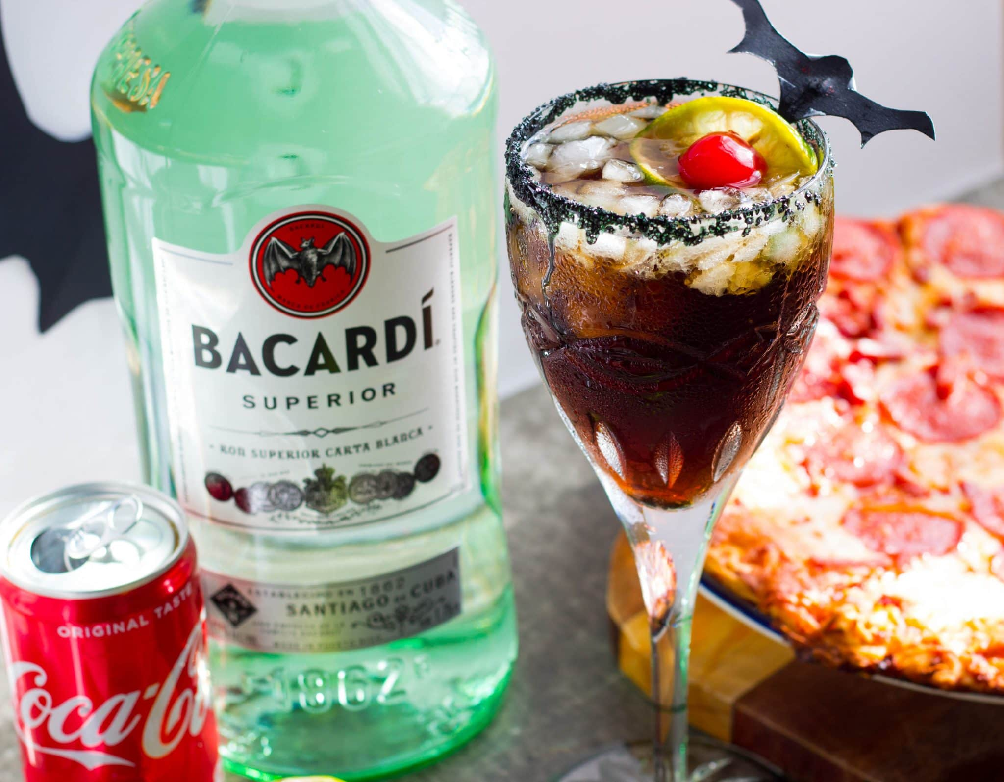 """BACARDÍ® rum & Coke Bat Tears Halloween Cocktail forms cool """"bat tears"""" with condensation and black sugar crystals that's perfect for your Halloween party!"""