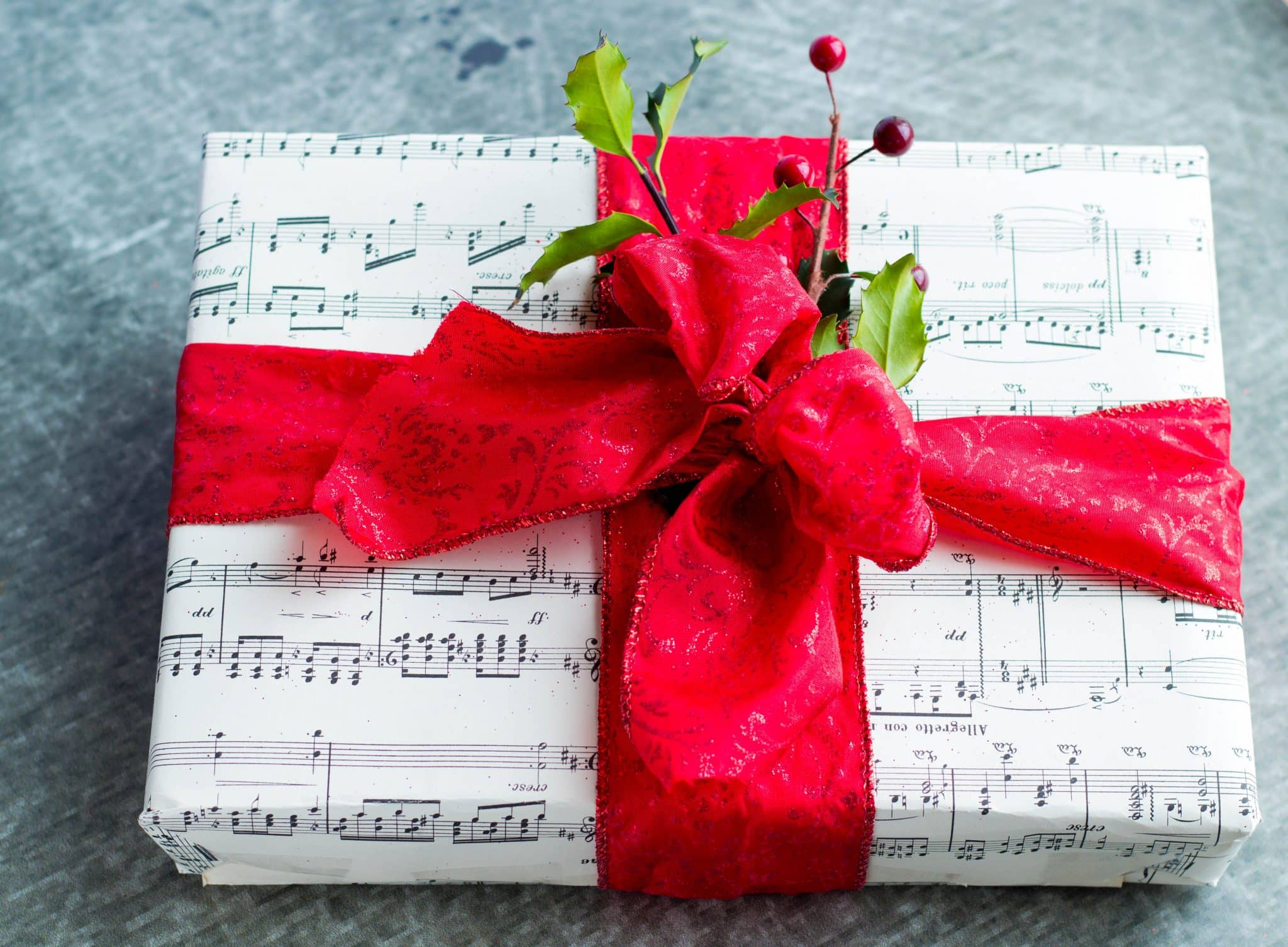 This DIY tutorial on How to Wrap a Gift Box with Sheet Music in a Snap is a creative way wrap a gift.