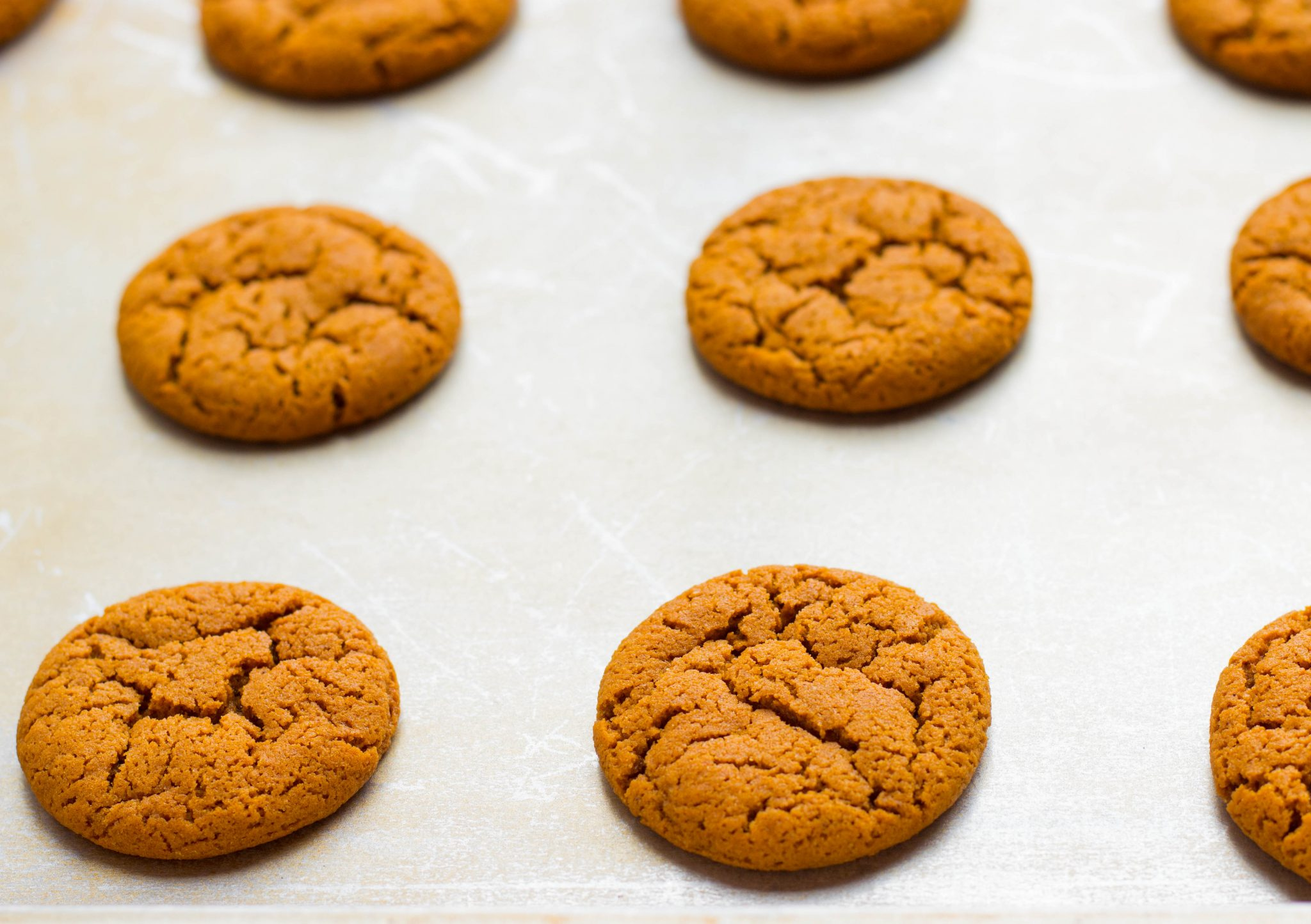 Old Fashioned Chewy Molasses Cookies are crispy on the outside and chewy inside. Open your oven door to the aromas of the season- ginger, cloves & cinnamon!